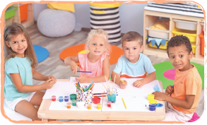 group of children sitting at table doing art